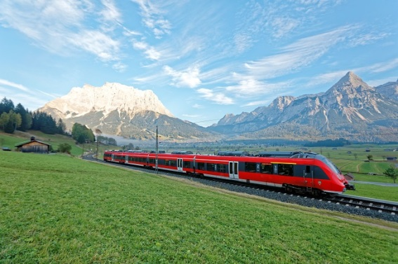 Train-in-Austrian-countryside-with-mountains-in-background.jpg